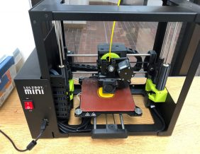 PLTW Engineering students experiment with 3-D printer.