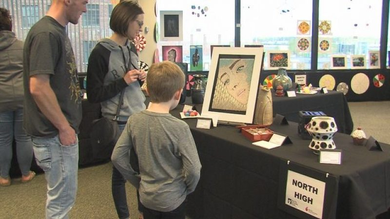 Visitors view student artwork displayed at the Ho-Chunk Centre.