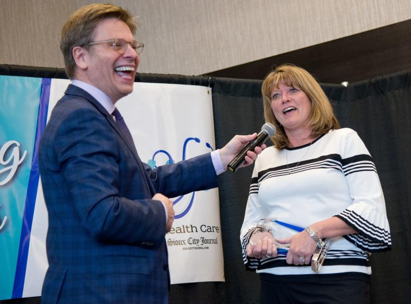 From the left, Sioux City Journal editor Bruce Miller poses a question to Sioux City Community Schools nurse Nancy Treft, an honoree of the Journal's Nurses: The Heart of Health Care Awards, in South Sioux City, Neb. on May 9, 2019.