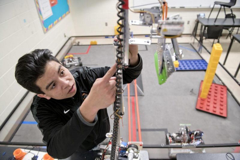 East High School 10th Grader Carlos Gomez Paz works on a robot in a classroom. Photo by Jesse Brothers, Sioux City Journal. In a post-apocalyptic world in which man and robots rule the planet, there will be one product more valuable than gold. That item, my friend, will be the rubber band! However, if you're in a pinch, scads of zip-ties will do just as well.