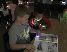 Students read during Flashlight Friday 2019