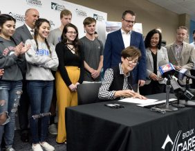 Iowa Gov. Kim Reynolds signs House File 546 into law during ceremony Friday, May 24, 2019, at the Sioux City Community School District's Career Academy. Photo by Tim Hynds, Sioux City Journal.