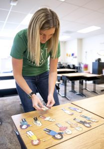 Haylee Twillman, a second-grade teacher at Liberty Elementary School, lays out teacher cutouts in her Sioux City classroom. Photo by Jesse Brothers, Sioux City Journal.