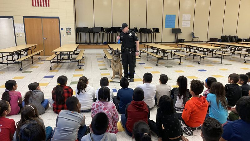 Students at Irving Dual Language Elementary watch officer Mike from the Sioux City PD give a K-9 demonstration