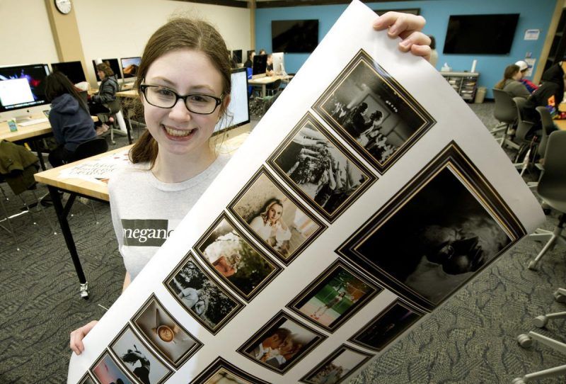 Megan Thompson, a junior at Sioux City East High School, displays her semester photography portfolio. Photo by Tim Hynds, Sioux City Journal.
