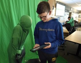Two students use a green screen during an eighth-grade video production class at West Middle School. Photo by Tim Hyndes, Sioux City Journal
