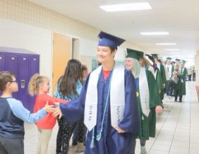 Students from North High and West High make their way down the halls of Perry Creek Elementary.