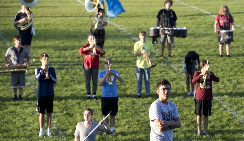 Drum major Reed Adajar listens to instructor Brian Cole (not shown) during an early-morning marching band practice Aug. 29 at the Sioux City school. The band has been rehearsing its half-time and competition program since Aug. 5. Photo by Tim Hynds, Sioux City Journal