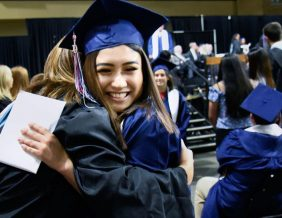 North High graduate Abigail Calderon embraces teacher Alisha Jelken during the graduation ceremony at Tyson Events Center in Sioux City on Saturday. Photo by Justin Wan, Sioux City Journal.