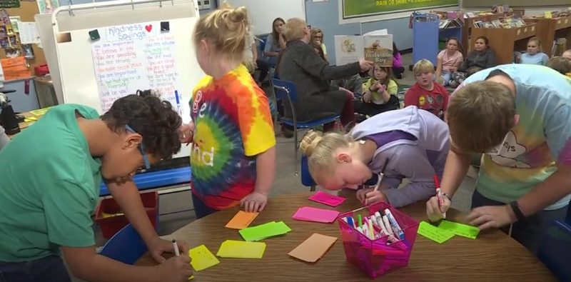 Students write kind notes for their fellow students as part of the Riverside Kindness Club