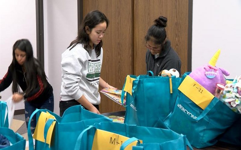 Sioux City West Students help prepare for National Adoption Day. Photo by Travis Hoffer KTIV.