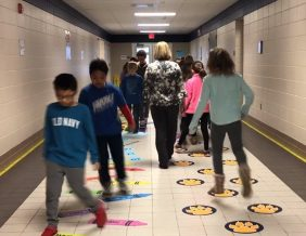 Students at Loess Hills Computer Programming Elementary get active with new sensory floor