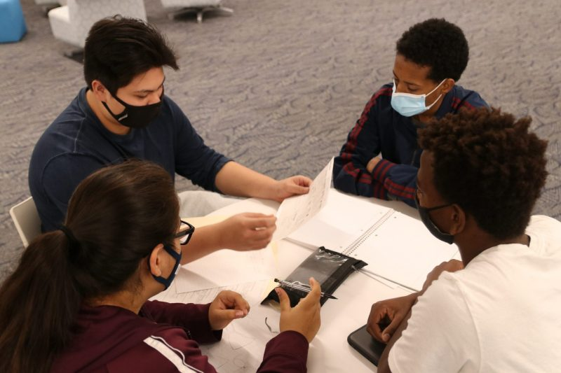 Clockwise from left: North High School's Hermon Alemu, Siouxland Christian Community School's Josh Etherington, North High School's Gissel Zamora-Montoya and North High's Daniel Nguyen discuss future plans during a Business Entrepreneurial class at the Sioux City Community School District's Career Academy.