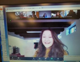 North High School senior Catrina Tounjian participates in a Zoom conversation, along with classmates Tinh Tran (top, second from left) and Areeha Ilyas (top, third from left).