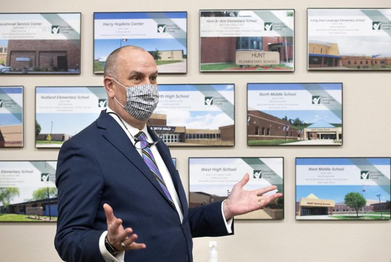 Dr. Paul Gausman, Superintendent of the Sioux City Community School District, pauses in front of a display of the District's school buildings before conducting a news conference on 2/1/2021. In the news conference Dr. Gausman explained the District's plans to create a K-12 virtual school. Photo by Tim Hynds, Sioux City Journal.