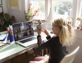 A child shows her classmates her art creation on video conference call. PHOTO BY JESSIE-CASSON // GETTY-IMAGES