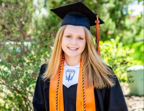 East High School's Trinity Edwards poses in cap and gown