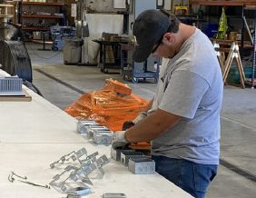 Cale McWilliams works on a project at Thompson Electric