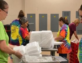Employees of the School District's food service department prepare to-go lunch meals for students.