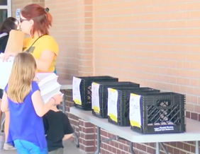 Students pick up free books during covid school closures