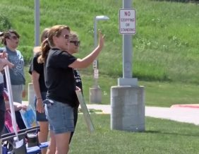 Teachers help celebrate last day of school with reverse parade