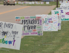 Techers from Perry Creek Elementary Surprise Students With Yard Signs
