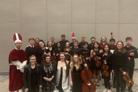 Members of the NHS Orchestra Pose for a Group Photo at the 2019 Madrigal Performance