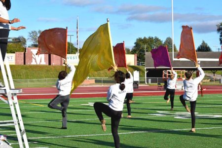 North High Color Guard Practices Drill with Flags