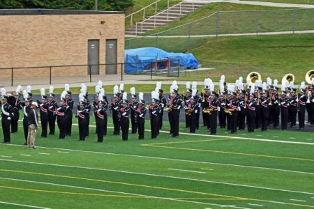 North High Marching Band Takes the Field in Full Uniform