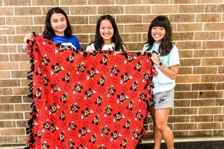 Members of NHS Student Council Make Tie Blankets for the Ronald McDonald House During the 2019-2020 School Year