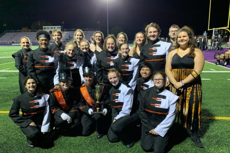 EHS Marching Band Seniors Pose on the Field