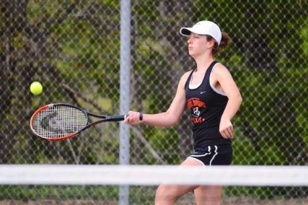 East High Tennis Player Hits the Ball
