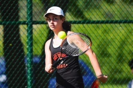East High Tennis Player in Action