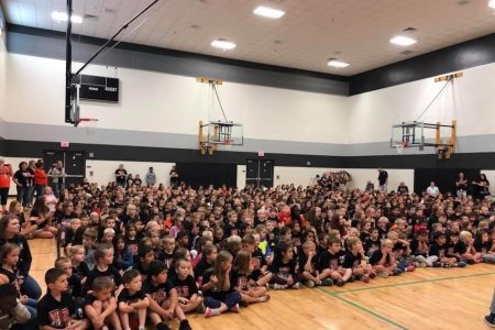 Raiders Together Elementary School Assembly With Black School Spirit