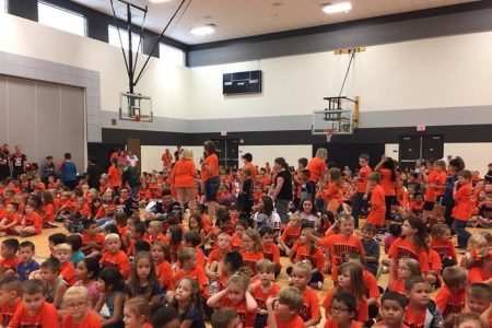 Raiders Together Elementary School Assembly With Orange School Spirit