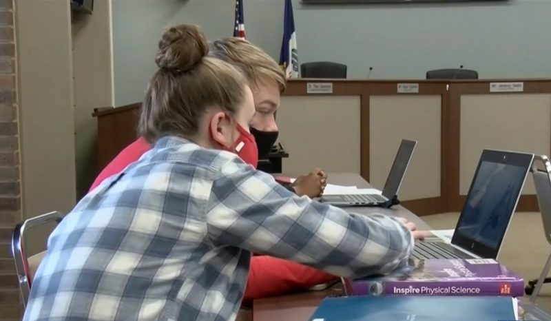Students look at a computer during health science class in the SCCSD board room.